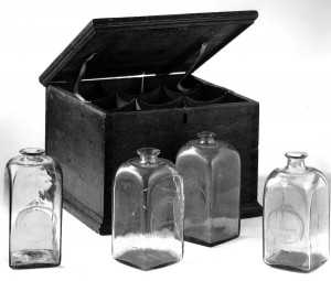 Case bottle, 1973.357, with other bottles and case